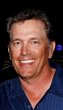 George Strait I have never seen him without his hat on