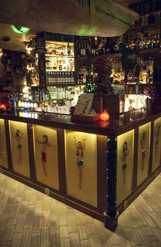 Aku Aku Tiki Bar opened in May 2007, in the Grünerløkka neighborhood of Oslo. Some of the decor is on loan from the Kon-Tiki Museum, including a large canoe hanging from the ceiling. The walls are lined with straw matting. Classic tiki drinks are served i...