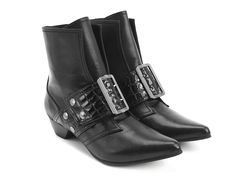 """With no secrets to keep locked up, Truth-tellers like The Cheryl have a way with relaxation and comfort. An easy-to-wear, slip-on bootie with a relaxed collar and our classic Pilgrim buckle, The Cheryl is a silver studded certainty with a crocodile patent strap over the foot, rubber soles and a 1.5"""" leather wrapped heel. These beauties are named after a beauty at Fluevog HQ.Truth and integrity since 1970."""