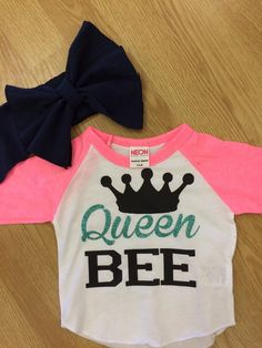 Queen bee raglan tee. Sleeves are neon pink with black and glitter jade writing. 3/4 sleeves Available in 3-6 mo, 6-12 mo, 12-18 mo, 18-24 mo, 2,4