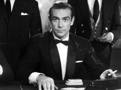 Classic shawl collar with the white pocket square...Old Hollywood glamour at it's finest.