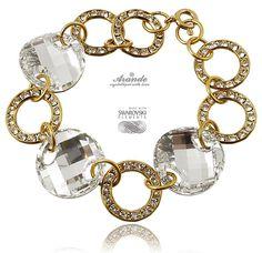 Idealna bransoletka na ślub w złoto-srebrzystym kolorze! Duże kryształy Swarovskiego połączone z pierścieniami wysadzanymi mniejszymi kryształami. Zobacz w sklepie Arande: http://arande.pl/store/pl/p/SWAROVSKI-SPECIAL-Bransoletka-COMET-ZLOTE-SREBRO-/3609