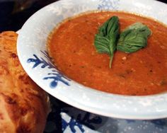 Recently had an extra pint of cherry tomatoes on hand and was in search of comfort food. Devised this soup in a pinch and thought it was worth sharing. Mine was a quick soup for one but the recipe has been scaled up and uses the more economical Roma tomato. If you have lots of cherry or grape tomatoes - they have a sweetness that pairs beautifully with the vinegar - use them or do a mix with the roma tomatoes. If you are making this Kosher, skip the cheese or be sure to use vegetable broth.