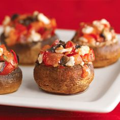 Our savory Greek-Style Stuffed Mushrooms are filled with olives, feta cheese, and tomatoes. More holiday appetizers: http://www.bhg.com/christmas/recipes/holiday-buffet/?socsrc=bhgpin121412greekstuffedmushrooms#page=4