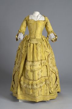 It's like Belles dress! Description Fabric is of yellow brocade with vertical straight and intertwined (alternating) columns of white silk sprays of red roses with. 18th Century Dress, 18th Century Costume, 18th Century Clothing, 18th Century Fashion, Rococo Fashion, Victorian Fashion, Vintage Fashion, Historical Costume, Historical Clothing
