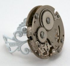 Our Filigree Steampunk Ring Handcrafted ring using a vintage watch. The circular movement was nestled to a antique white brushed oxidized plated brass open work ring form. $35.00 | #qacreate