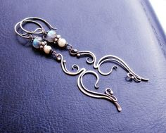 """Subtle light earrings from the collection """"Laconique"""", decorated with labradorite and white pearls"""