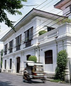 Get a feel of history from the front with the antique shutters and heavy duty doors amidst the white infrastructure. Spanish Colonial Homes, Spanish House, Spanish Style, Filipino Architecture, Philippine Architecture, Filipino House, Philippine Houses, Bungalow House Design, Indochine
