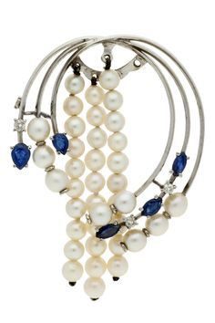 #Pearls and #sapphires #brooch, circa 1950  White #gold, pear and marquise cut sapphires, 1.14 cts, old brilliant cut diamonds, 0.24 cts and cultured pearls of 4.5-5 mm diam. Three rows of loose pearls.    6 cmx4.2 cm  17.7 gr