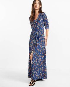 This blue floral maxi has a high front slit, convertible sleeves and v-neckline that add up to a casually sexy look with a bit of dramatic flair. Rendered in shirt-dress style, you'll want to keep this one at the front of the closet.