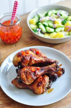 STICKY CHICKEN WITH MALAYSIAN SALAD from Rachel Khoo - use thighs and drums, cut salad in smaller cubes. Serve chicken around salad in middle of platter, sprinkle with sesame seeds on chicken Honey Soy Chicken, Sticky Chicken, Easy Asian Recipes, Easy Chicken Recipes, Fancy Dinner Recipes, Dinner Ideas, Chinese Dinner, Summer Grilling Recipes, Feel Good Food