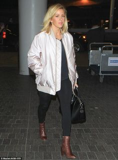 Stylish as ever: The 28-year-old dressed her slender curves in an off-white satin jacket and tight black jeans