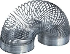 Buy Retro Slinky at Mighty Ape NZ. This retro edition Slinky® is packaged in a retro blue box and is made of original silver metal! Originally developed as a kids toy, the Slinky is lo. Retro Toys, Vintage Toys, Vintage Games, Vintage Stuff, Childhood Toys, Childhood Memories, 1970s Childhood, Slinky Toy, Stocking Stuffers For Men