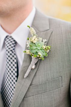 A boutonniere of succulents, snowberries, and spirea | Brides.com
