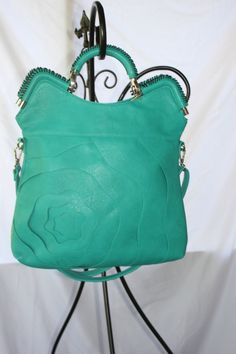 Alyssa Elite Handbag in Teal $70.00  Go to jtnmissions.org to order yours today!  100% of the proceeds go to missions local and worldwide.