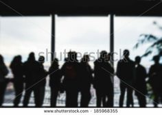people silhouette looking through windows of high view skyscraper - stock photo BUY IT FROM $1 ON SHUTTERSTOCK