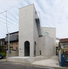 The uppermost staircase of this Japanese house climbs one of the exterior walls