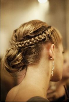 This elegant braided bun is the perfect look for your next big event.