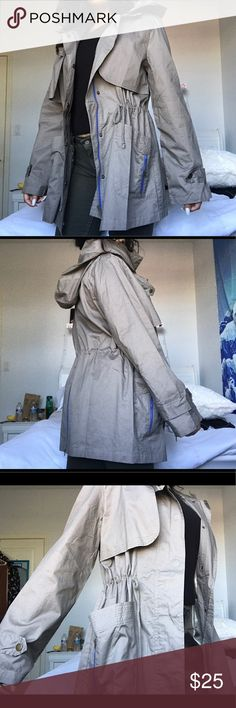 Military Green Hooded Parka Military green color. Rustic gold zippers with blue detailing around the zippers. Waist ties on the inside to cinch in the waist. Large hood. 2 Front pockets. Zipper closure as well as button closure. NWT. Never worn. Forever 21 Jackets & Coats Utility Jackets