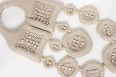 Gerrit Rietveld Academie - Mirela Srsa 2009 material: cotton, beans, thread, buttons technique: sewing, embroidery, crochet dimensions: 62x26.5x4 cm