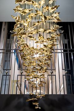 We mirrored the design of the magnificent balustrude staircase in this palatial Kensington home as the backdrop for the hand-blown gold chandelier that cascades from above it. The metalwork is bronze powder coated and contrast with chrome spheres. Gold Chandelier, Modern Chandelier, Chandeliers, World Of Interiors, House Interiors, Entryway Lighting, Autumn Lights, House On A Hill, Luxury Home Decor