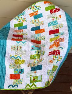 Baby boy quilt made with blues and reds and greens from a charm pack