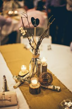 Rustic wedding centerpiece - candles - burlap table runner - mushrooms - table numbers - diy wedding - branches
