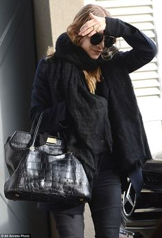 Still not confirmed? Mary-Kate Olsen stepped out wearing a gold band on her left ring fing...