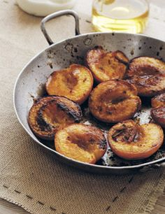 Cinnamon roast peaches with vanilla yogurt.     4 peaches, ripe but firm    1 teaspoon ground cinnamon    1 tablespoon light brown sugar    1 tablespoon butter or sunflower oil    2 cups low-fat Greek yogurt    1 teaspoon vanilla extract    1 tablespoon agave syrup or honey  Fresh mint leaves