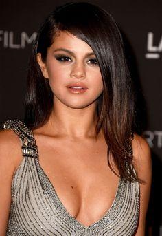 Selena Gomezat LACMA Art + Film Gala 2014in L.A. Makeup: Winged smokey eyes, rose-peachy cheeks,and peach-nude lips.
