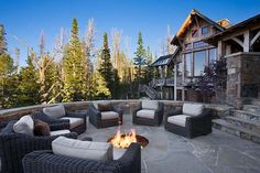 Summit Residence is a sensational rustic mountain retreat designed by Locati Architects, located in the prestigious ski resort community of Yellowstone Club, Big Sky, Montana. Outdoor Fire, Outdoor Living, Outdoor Spaces, Outdoor Kitchens, Outdoor Ideas, Porches, In Ground Fire Pit, Montana, Yellowstone Club
