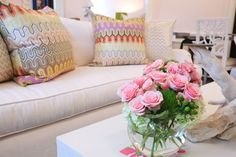 These pillows and the floral arrangement are very special accents against the white!