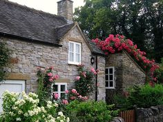 Stone Cottage with climbing Roses