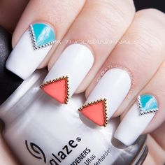 White nails with coral turquoise triangled tips lined with gold silver caviar free hand nail art