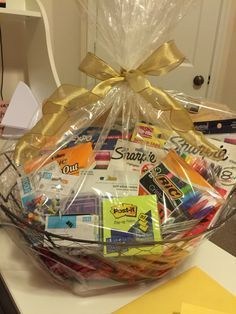 Office supply gift basket- great idea for new employee welcome ( can make the basket smaller and fill with the essentials plus add a map of the neighborhood and points of interest) College Gift Baskets, Teacher Gift Baskets, Themed Gift Baskets, Diy Gift Baskets, College Gifts, Teacher Gifts, Basket Gift, Fundraiser Baskets, Raffle Baskets