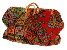 CIVIL WAR ERA CARPET BAG Purse-like satchel for carrying personal belongings popular during the Civil War period through the 1870s. Offered is a colorful, wool bag with muslin lining, divided in two compartments at center. Each side is constructed of two different designs: stylized red, blue, green, orange and black on one side, and on the other a Native American motif. The two semicircular handles are leather covered, one separated near attachment with part of leather covering lacking. A…