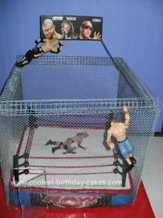 Homemade Steel Cage Wrestling Cake: This Homemade Steel Cage Wrestling Cake was made for a dear friend of the family. She asked simply for a WWE wrestling cake. I can say with all honesty-I