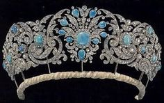 A floral tiara of diamonds and flawless deep blue turquoises, which belonged to Princess Alice, The Duchess of Gloucester.