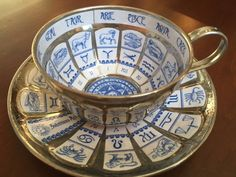 DIY Astrology / Fortune Telling tea cup. Thrift store metal tea cup. Mod Podged blue and white printed paper. Sealed with high gloss polyurethane.
