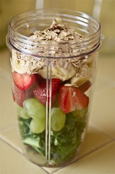 Kale, Grapes, Strawberries, Banana, Flaxseeds, Oats, Add Coconut Milk & Blend.