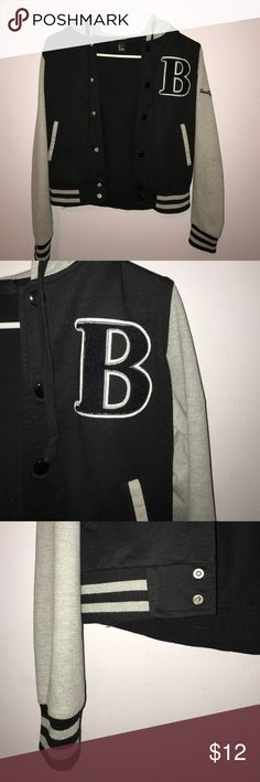 Forever 21 Varsity Jacket Black and gray forever 21 varsity jacket. B on the side of the jacket and varsity team in cursive letters on one of the sleeves. Buttons up with no zipper. Has two pockets. Forever 21 Jackets & Coats