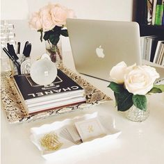 Fancy office decor: love the python desk tray + white roses.