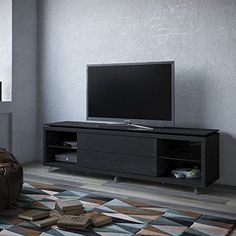 "Manhattan Comfort Lincoln 2.2 Series 85"" TV Stand in Black. Free Standing TV Stand for Living Room and Bedroom use. Upon Assembly, measures: 76.77 inches in Length, 21.22 inches in Height, 17.63 inches in Depth. Recommended for 60"" TV. No Mount Needed. Have your TV sit on a Classy and Contemporary Stand. Ample Storage Space with Media Holes for Wire Management."