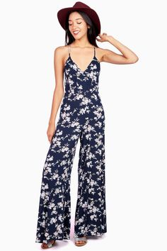Floral print jumpsuit with a surplice neckline and crossed back straps…