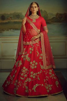 Sabyasachi Wedding Red Lehenga In Silk Malai satin silk red lehenga with can-can net layered. Embroidery on lehenga with silk blouse fabric and dupatta. The wedding lehenga choli will be customised up to bust inches, UK size