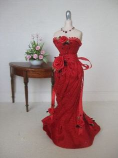 Ladies red gown on mannequin