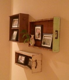 Antique drawers upcycled into family photo wall.  These are from the family farm and date back to the 40's.