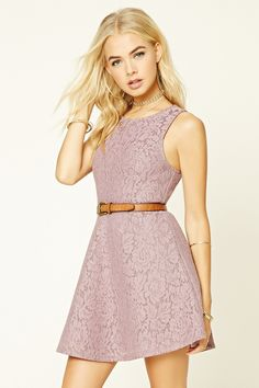 A sleeveless fit and flare dress crafted from woven floral lace featuring an exposed back zipper and a round neckline.