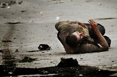 Man shot by a sniper in Aleppo, Syria by Javier Manzano