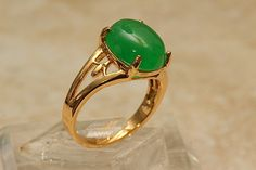 DESIGNER OVAL SHAPED 9 MM BY 12 MM JADE RING/span> This Jade ring features one gorgeous oval shaped 9mm by 12mm fine quality Jade gemstone set into this fine gold ring setting. The stone has been hand cut and polished to a fine finish. The quality, color and clarity of the stone is excellent, the translucent quality of the Jade is also excellent. Available sizes: 6,  7 Made of genuine fine quality Jade